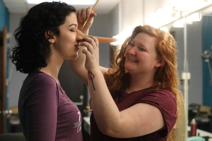 Student getting fitted for a prosthetic nose